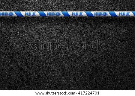 English white-blue police line in the background smooth asphalt road. Police line do not cross. The texture of the tarmac, top view. - stock photo