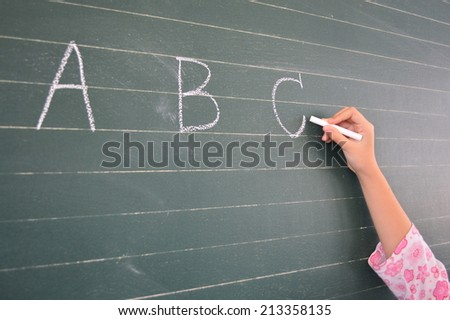 English writing for the beautiful hand with the blackboard in the school. - stock photo