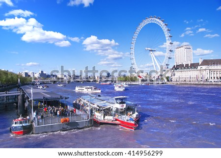 ENGlLAND, LONDON- APR 25: View of the river Thames with ships and ferris wheel 25 April 2009