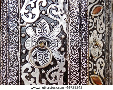 Engraved moroccan door in Marrakech - stock photo