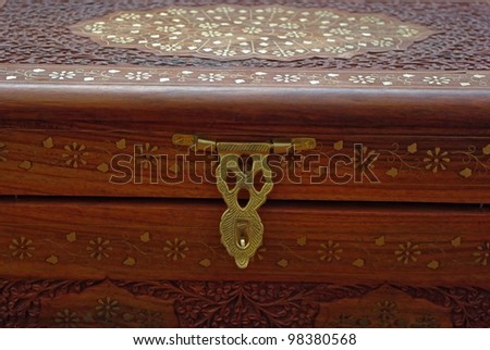 Engraved wooden chest  with metallic inlay ornament. - stock photo