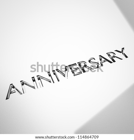 engraving of anniversary words on silver or platinum surface, for celebrations.