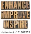 enhance, improve, inspire - a collage of isolated motivational word in vintage letterpress wood type - stock photo