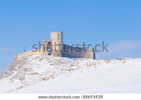Enisala Fortress in winter landscape - stock photo