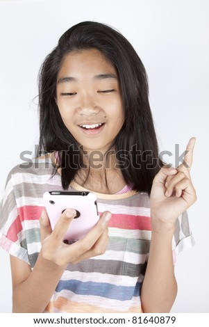 enjoy smartphone, Asian teenage using her smart phone with happy face.