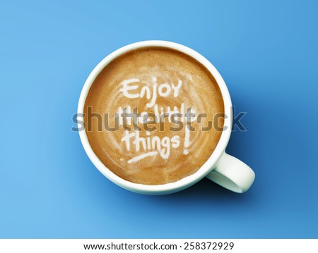 Enjoy the Little Things Coffee Cup Concept isolated on cyan background - stock photo