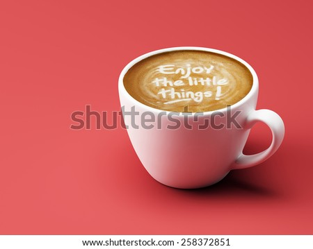 Enjoy the Little Things Coffee Cup Concept isolated on red background - stock photo