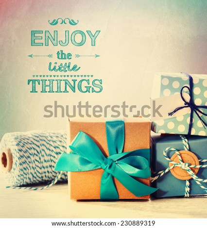 Enjoy the little things with light blue handmade gift boxes - stock photo