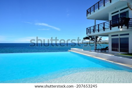 Enjoy the ocean view infinity pool on vacation - stock photo