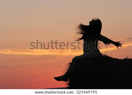 Enjoy the sunset at countryside - stock photo