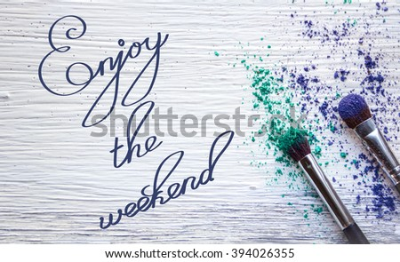 Enjoy the weekend Inspirational quote  Urlaub, Sommer concept lettering  posters writing notebook note turquoise wooden background Word refer news, current affairs, special occasions business planning - stock photo