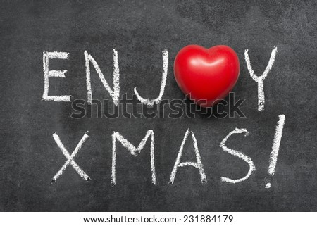 enjoy Xmas exclamation handwritten on chalkboard with heart symbol instead of O