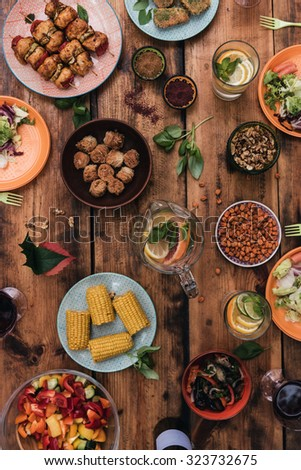 Enjoy your dinner! Top view of food and drinks on the rustic wooden table - stock photo