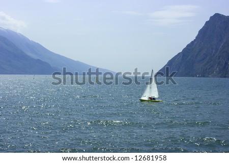 Enjoyable sailing on a small boat on Garda Lake - stock photo