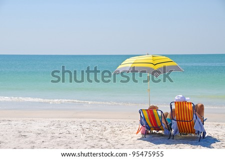 Enjoying a Day at the Beach - stock photo