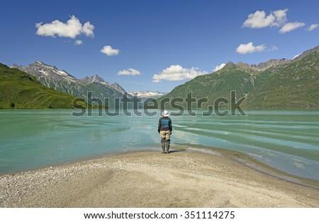 Enjoying a Spectacular View of Crescent Lake on a Sunny Summer day in Lake Clark National Park in Alaska - stock photo