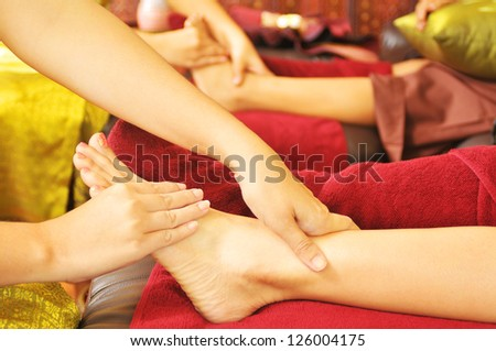 Enjoying and relaxing healthy foot massage - stock photo
