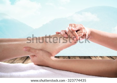 Enjoying and relaxing healthy foot massage close up - stock photo