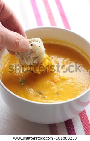 Enjoying carrot and coriander soup - stock photo