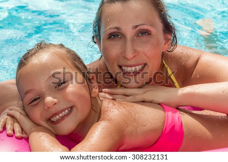 enjoying cool water on pneumatic air bed - stock photo