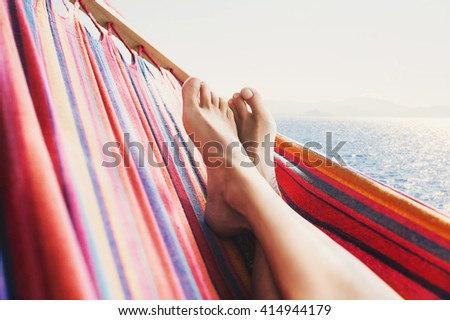 Enjoying life. Hammock above the sea, vacation concept - stock photo