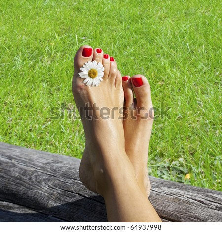 Enjoying pure relaxing time by a beautiful summer day. - stock photo