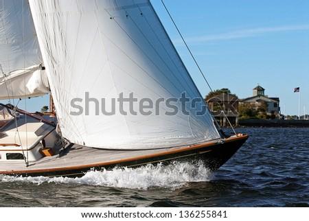 Enjoying sailing along Newport Harbor under full sail. - stock photo