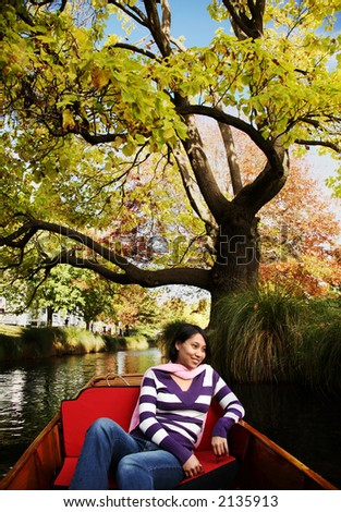 Enjoying scenery at christchurch while punting in Avon river - stock photo