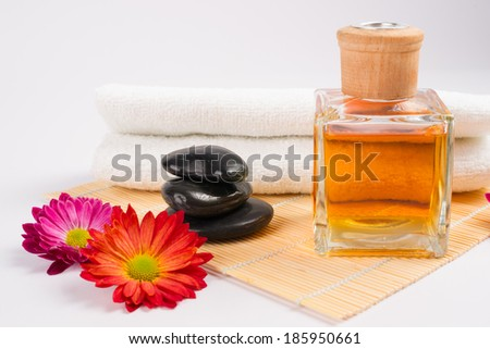 enjoying spa with flowers,massage stone and aroma oil