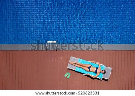 Enjoying Suntan Vacation Concept Top View Stock
