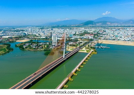 Enjoying the Tran Thi Ly Bridge and Da Nang city by helicopter tour is very interesting.