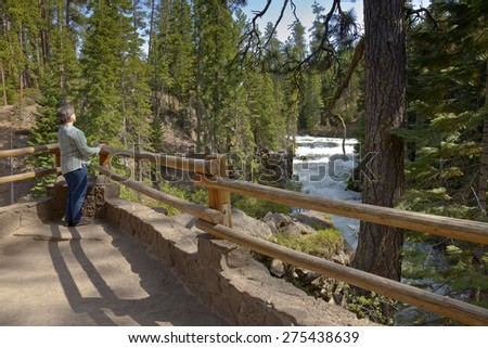 Enjoying the view of the river flow in central Oregon. - stock photo