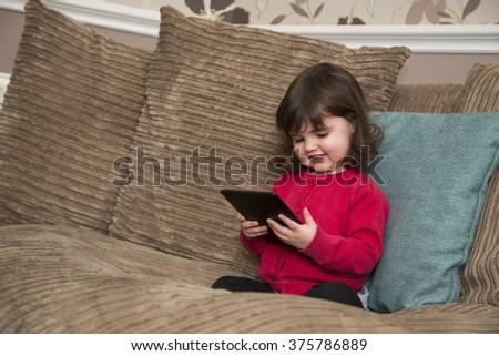 Enjoying watch the tablet - stock photo