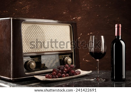 Enjoying wine and listening to the radio - stock photo