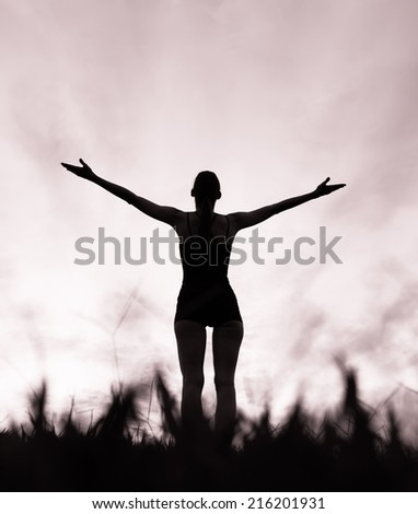 Enjoyment - Free happy woman enjoying sunset in Hawaii. Freedom concept. Sunbeams. - stock photo