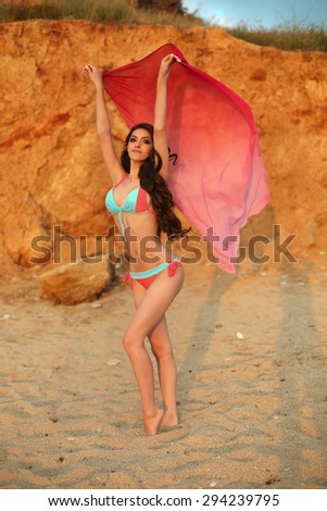 Enjoyment sunset. Beautiful Young Woman in Bikini on the beach, fit sporty healthy sexy body girl, freedom, vacation, summertime concept. - stock photo