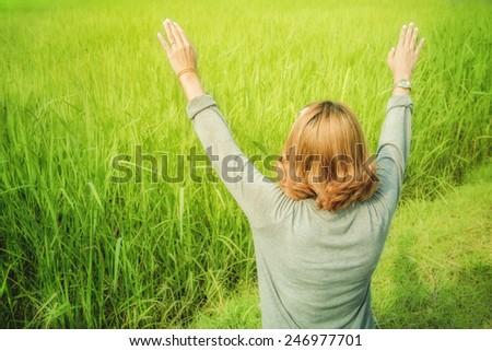 Enjoyment - woman enjoying freedom or celebrating winning success at - stock photo
