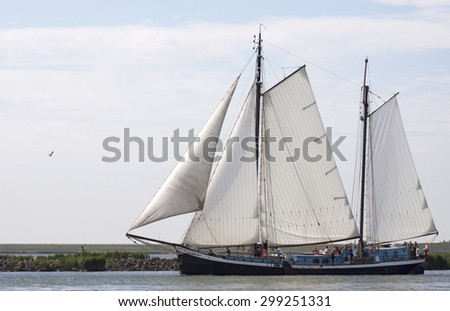ENKHUIZEN, THE NETHERLANDS - JULY 18,2015: Vintage traditional  wooden sailing ship under sail leaving the port of enkhuizen with sunny weather on july 18 , 2015 in Enkhuizen, Holland.