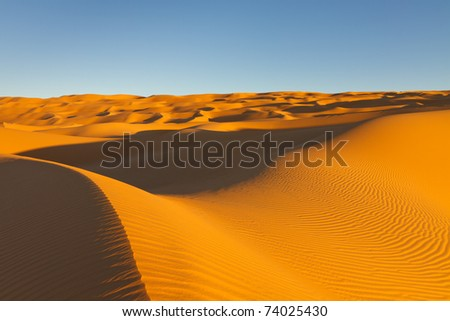 Enless Sand Dunes at Sunset in the Awbari Sand Sea, Sahara Desert, Libya - stock photo