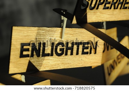 ENLIGHTEN on a wooden sign, photograph Aspirations word
