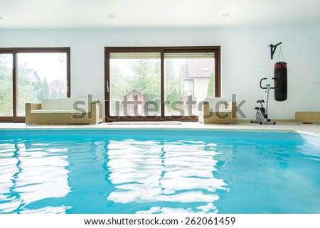 Enormous luxury residence with interior swimming pool - stock photo