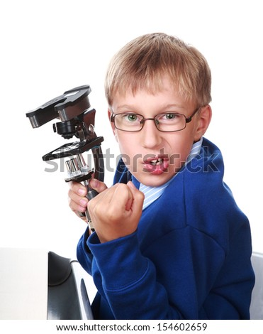 Enraged blond boy in a blue sweater holding a microscope and shouting (isolated on white background) - stock photo