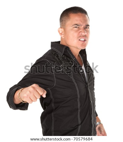 Enraged Hispanic man with fist on white background - stock photo