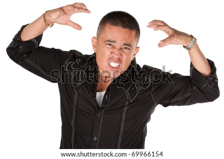 Enraged middle-aged Hispanic man with raised hands on white background - stock photo