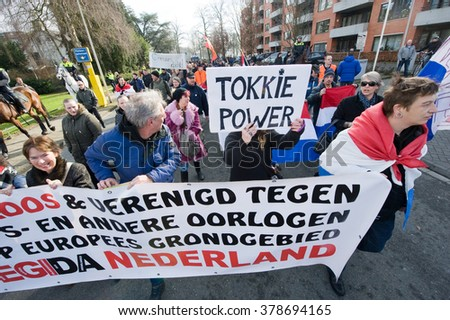 ENSCHEDE, THE NETHERLANDS - FEB 13, 2016: People are demonstrating against a huge migrant refugee camp for muslim war refugees close to the part of the city where they live. - stock photo