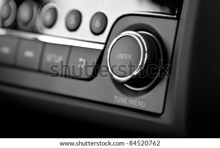 Enter button and knob on a car's dashboard - stock photo