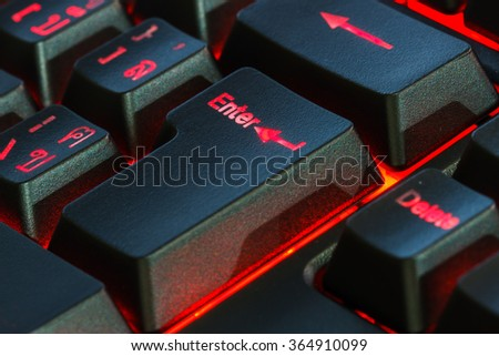 Enter keyboard button in low key with red light