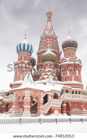 Enter to St. Basil Temple in Moscow, Russia at wintertime during snowfall - stock photo