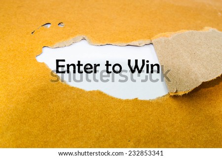 Enter to win concept on brown envelope  - stock photo
