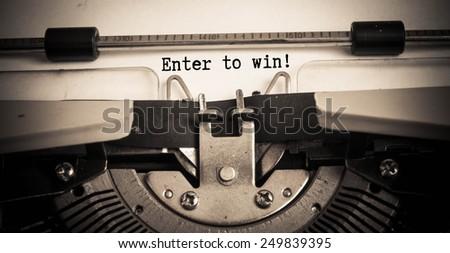 Enter to win concept on typewriter  - stock photo